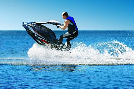Many people like to do tricks on jet skiis like the one seen in this picture; however, these tricks often lead to injuries and boating accidents. Contact a Metairie boating accident lawyer or Louisiana jet ski lawyer today.