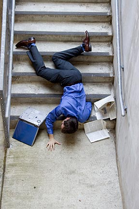 This picture is a simulation of what it may look like when a man falls down stairs. Slip and fall accidents, sometimes referred to as trip and falls, are covered by an area of law called premises liability. Contact a Metairie premises liability attorney today to represent you in your slip & fall injury claim.