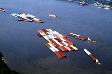 This is a fleet of barges like those that float up and down the Mississippi River. If you were injured on a barge near Metairie or in Southeastern Louisiana, call a Metairie Maritime Attorney today.